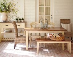 A Carmichael Dining Table is a natural for wooden or rattan seating.