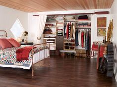 Reach In Closet - organized / styled in keeping with nautical theme of room - curtain rod made from old oar