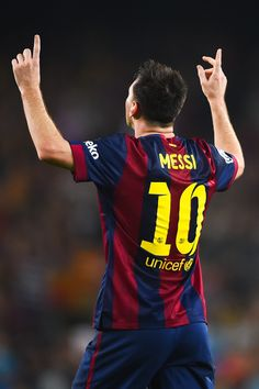 Lionel Messi of FC Barcelona celebrates after scoring his team's third goal during the La Liga match between FC Barcelona and SD Eibar at Camp Nou on October 18, 2014 in Barcelona, Catalonia.