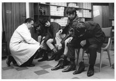 'Mods' try on Beatle boots at Annello and David, 1965 Beatle boots are tight-fitting, Cuban-heeled, ankle-high boots with a sharp pointed toe, made popular in the early 1960s by the Beatles pop group.