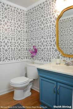 Our Mansion House Grille Trellis Wall Stencil in an allover trellis pattern inspired by classic metalwork. The graceful grillwork trellis pattern allows you to stencil a custom wallpaper look on walls
