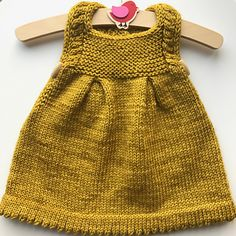 This irresistible little pinafore is a very fun and quick knit, with thoughtful details and easy-yet-effective techniques. The result is a crisp, well-finished, adorable garment. Perfect as a sweet dress for special occasions, it also works as a practical layering piece for every day play.