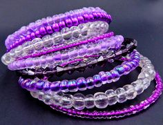 This darling lilac memory wire wrap bracelet is made on 9 rows of silver memory wire with glass Czech beads and crystals in gorgeous shades of lavender and purple. ★ Return to my main shop page here for more inventory ★ www.etsy.com/shop/bridgetollbeading ★ Read my FAQs below and if you have any further questions please do not hesitate to contact me! ★ https://www.etsy.com/shop/BridgeTollBeading?ref=hdr#more-section