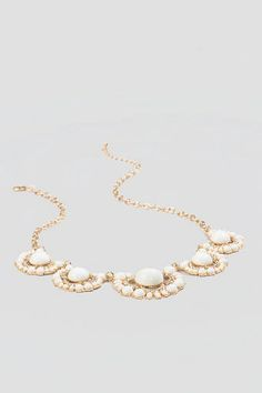 Malone Statement Necklace Ivory Stone Cers Are Accented With Crystal Rhinestones Golden Filigree Details To Create A Beautiful