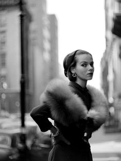 Sandy Brown is wearing a natural red fox circle by Hattie Carnegie worn over her slim-skirted navy blue wool dress, photo by Gordon Parks, O...