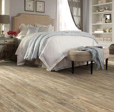 A lighter wood floor with beautiful detail will bring a fresh look to your bedroom.  Tectona Teak 24930 | Luxury Vinyl Plank Flooring | IVC US Floors www.ivcfloors.com