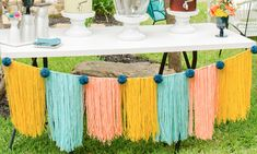 Colorful yarn banner at a modern teen girls graduation party. See more from this Grad Party on Mint Event Design www.minteventdesign.com