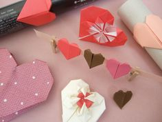 i've been working on my origami skills. they're still pretty lacking but i think i could pull off some of these adorable hearts