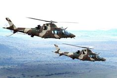 South African Air Force Agusta A-109 helicopters in flight.