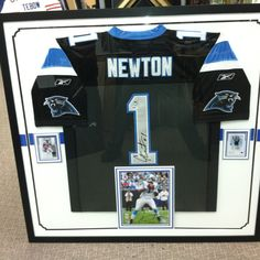 Newton jersey, cards and photo autographed display!
