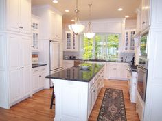 4 Fair Tips AND Tricks: Kitchen Remodel Brown Subway Tiles u shaped kitchen remodel cleanses.Kitchen Remodel Cost Apartments kitchen remodel before and after stains.U Shaped Kitchen Remodel Range Hoods. Kitchen With Long Island, Kitchen Layouts With Island, New Kitchen, Kitchen Island, Kitchen Cabinets, Kitchen Floor, Narrow Kitchen, Wood Cabinets, Square Kitchen