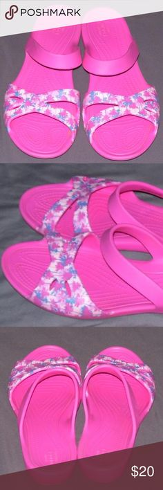 """Crocs Pink Palm Tree Sandal Shoe Sz 10 Casual Crocs Kelli Graphic Sandals  Style: 204462  Size 10  Croslite material  Pink with pink/lilac/blue palm tree graphics  *Textured footbed  *Heel is approx 1""""  Excellent condition. Look close to new. CROCS Shoes Sandals"""