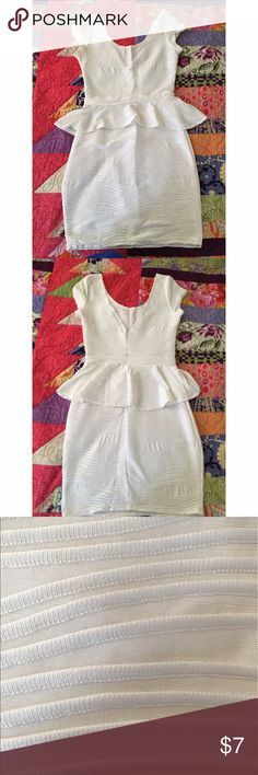 White Dress Hugs the body nicely with a small peplum. Worn only twice! Dresses Mini