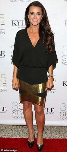 love the dark flowy top with the metallic skirt