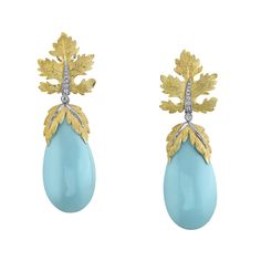 """Large Turquoise earrings entirely hand engraved in the traditional """"Florentine"""" style."""