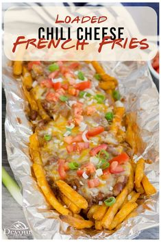 This is the Easiest Chili Cheese Fries on the Planet. I've perfected fun and easy recipes to whip out with company that will thrill everyone with a last minute snack. Chili Cheese Fries is one of those recipes I have in my back pocket. #devourdinner #devourpower #familyrecipes #familyrecipe #chilicheesefries #tinfoildinner #campingrecipes #grilled #baked #frenchfries #recipe #easyrecipe #easyrecipes #yum #yummy #buzzfeast #snackrecipe #easyrecipe