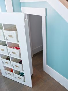 Secret storage behind other storage... Slides out on casters? HGTV Smart Home 2013: Artistic View : Page 19 : HGTV Smart Home : Home & Garden Television