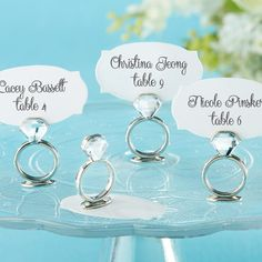 With this ring, I thee... lead guests to their seats. Showcase guests' names and table numbers or a personal photo with help from these ring place card/photo holders.