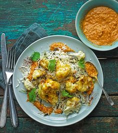 We've given this quick midweek meal a Spanish twist with a smoky romesco sauce. It complements the cauliflower brilliantly.