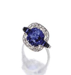 SAPPHIRE AND DIAMOND RING, FRENCH, CIRCA 1930.  The cushion-shaped sapphire weighing 3.81 carats, framed by single-cut and square-cut diamonds, flanked by calibré-cut sapphires, mounted in platinum, size 5¾, French assay mark, numbered 91217.
