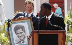 NASSAU, BAHAMAS - MARCH 04: Prince Harry is presented with a portrait in Rawson Square ahead of an opening of the Queen's Jubilee Exhibition on March 4, 2012 in Nassau, Bahamas.