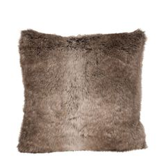 Faux fur desert foxcushion from the Occa Winter collection. The cushion is knitted from a composition of yarn and other fibres to give the impression of an authentic long-hair accessory. It comes in a mixed finish with dark shades of brown, black and white, adding a luxurious feel to the accessory. Soft, warm and welcoming, it will make a perfect addition to the sofa or chair in the living area or to your bedding accessory arrangement. Cuddle up in yours during the cosy nights spent ...