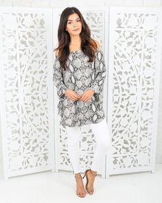 Obsessed with our gorgeous Arvada Off The Shoulder Tunic! A snakeskin printed tunic with tie sleeves and a secure off the shoulder fit. Pair this with sandals b