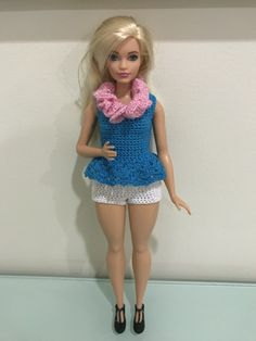 Learn how to crochet a peplum top, shorts, and lei for Barbie! She'll be beach ready in no time. Barbie Clothes Patterns, Crochet Barbie Clothes, Clothing Patterns, Barbie Top, Barbie Dress, Crochet Baby Dress Pattern, Crochet Patterns, Fashion Dolls, Fashion Outfits