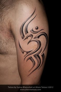 Tribal OM tattoo, Design and Inked by Sunny at Aliens Tattoo, Mumbai. Client went to couple of famous tattoo studios around Mumbai. Hindu Tattoos, God Tattoos, Taurus Tattoos, Religious Tattoos, Dream Tattoos, Arrow Tattoos, Symbolic Tattoos, Tribal Tattoos, Tattoos For Guys