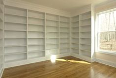 Entire wall of built in bookcase shelves.