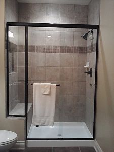 Nice Idea For Basement Shower. Cheaper Shower Door And Lighter Tile Or  Prefab Shower Stall.
