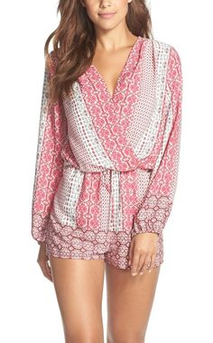 Too cute! A surplice neckline and loose-fitting silhouette define this pink patterned, ultra-versatile woven romper.