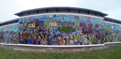 The finished Mayfield and Easthouses Big Wall mural after installation. Muralist and artist Chris Rutterford facilitated this schools community project just outside of Edinburgh, Scotland.