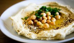 Hummus plates, tahini, and even Domino's Pizza are helping transform the Land of Milk and Honey into a vegan haven.