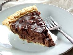This vegan chocolate pecan pie is made with a rich, fudgy, pecan-packed pie filling that's loaded with chocolate and has just a hint of cinnamon.