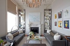 A Marvellous Bronze Pointed Chandelier Idea For Living Room With The Glass Decoration Shelf And Various Photo Frame With The Simply Long Sofa And Glass Coffeetable Luxurious Chandelier in Living Room as Decorative Illumination living room Apartment Interior Design, Interior Design Living Room, Living Room Designs, Room Interior, Two Bedroom Apartments, Apartment Living, Living Rooms, Apartment Furniture, City Living