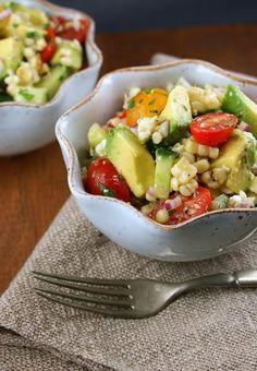 Delish! Avocado, tomato, corn, and cucumber salad! by Laurensija