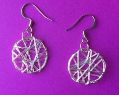 Items similar to Faceted Garnet Exterior Sterling Silver Wire Wrapped Hoop Earrings on Etsy