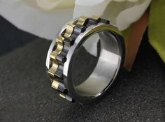 Moveable Gear Steampunk Ring Item Type: Rings Surface Width: 6mm Rings Type: Wedding Bands Metals Type: Stainless Steel Shape\pattern: Round Material: 316 Stainless Steel Lead&Nickel: Free Keywords: M