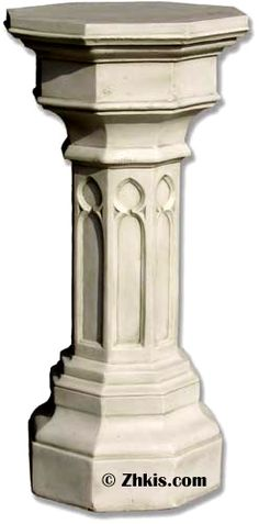 This tall narrow Gothic church pedestal. Is unique with its pointed arch window designs. A perfect pedestal for an old church.