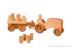 Our Natural Organic Wooden Toy Farm Tractor with Cart is designed and made in the USA by Countryside Gifts LLC and is lovingly handcrafted one at a time using the finest grade woods and materials. Woodworking Table Saw, Best Woodworking Tools, Woodworking Projects, Woodworking Classes, Woodworking Videos, Wooden Toy Farm, Farm Toys, Montessori Toys, Wooden Crafts
