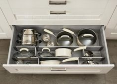 Pan Drawer Divider Kit Howdens general idea for larger drawer, frypan would fit on side due to depth of drawer ideally with an oak laminate (assuming it is hardy and will last.