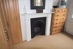 fireplace in the master bedroom. I'd like this with dark stone.