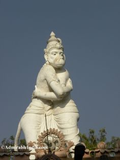 Huge statue at the top of temple where Lord Rama is hugging Hanuman