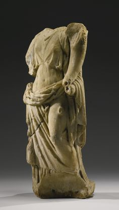 A ROMAN MARBLE FIGURE OF FORTUNA, CIRCA 1ST CENTURY A.D. standing with the weight on her right leg and holding a cornucopia cradled in her left arm, and wearing a chiton with overfold, and himation falling from her left shoulder across the back, extending over the lower part of her body, and draped over her left forearm; the extremities once restored in marble.