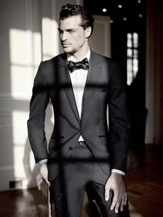 Handsome male model wearing the classic tuxedo