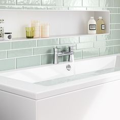 Faber Bath Filler Mixer Tap - BathEmpire. The mixture of white and soft aqua green creates the ideal background for the curvy bath taps and an ambience with the Wimbledon touch in your bathroom. These brand new bath taps have just landed and are one of our top pick for our Wimbledon white inspiration.