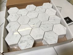 Italian Bianco Carrara Polished. An incredible lot. $11.75 a Square Foot, currently free shipping (why on a lot as good as this?). This is Italian Marble at it's very best. I just love opening up a crate and seeing this on a Monday morning!