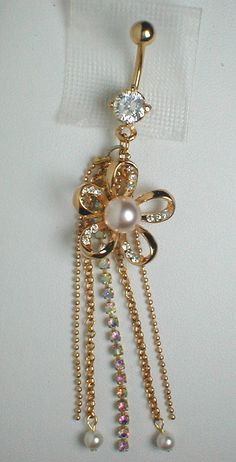 Unique Belly Ring - 9K GF Flower with CZ'S & Freshwater Pearls. $17.95, via Etsy.