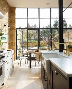 Explore this GORGEOUS south London home complete with exposed brick and Crittall features A little bit industrial, a little bit English country, this Victorian south London home has exposed brick walls, Crittall doors and a country kitchen. Küchen Design, House Design, Design Ideas, Crittal Doors, Crittall Windows, Kitchen Diner Extension, Kitchen Extension Victorian, Kitchen Extension Glass Doors, Glass Extension
